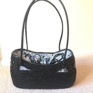 Black woven purse from Anthropologie